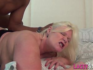 Mature Brit in stockings gets banged and sucks
